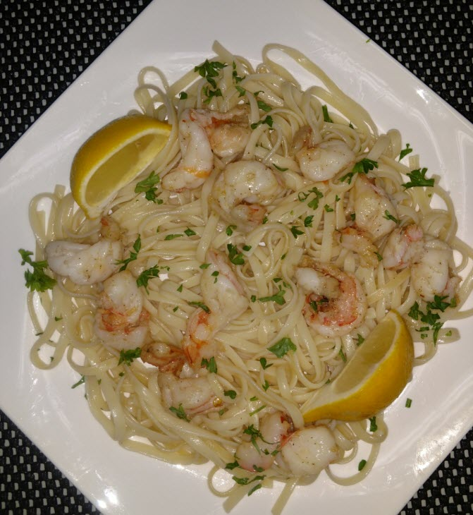 Shrimp Scampi with a olive oil and butter garlic sauce over linguini